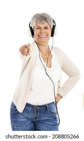 Elderly woman listen music with headphones, isolated over white background