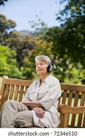 Elderly woman listening to some music