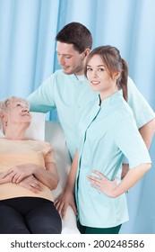 Elderly woman lying in a hospital, vertical