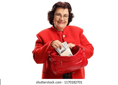 Elderly woman with money in a purse isolated on white background