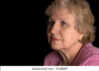 The elderly woman on black background