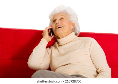 elderly woman on the couch with mobile