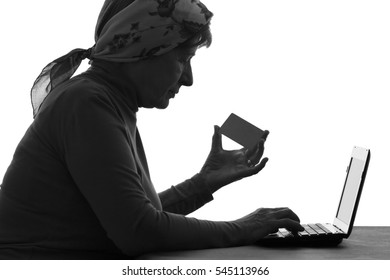 elderly woman pays for the services of a bank card on the Internet