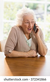 Elderly woman phone calling at home