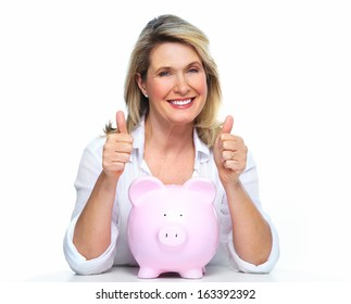 Elderly woman with piggy bank. Isolated over white.