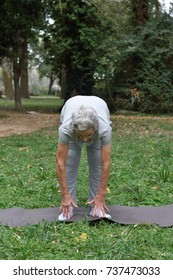 elderly woman practicing yoga outdoors