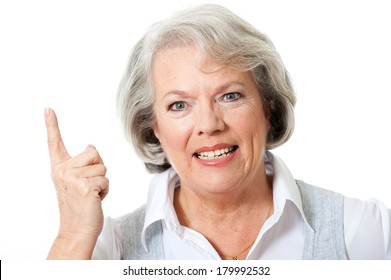 Elderly woman with a raised index finger