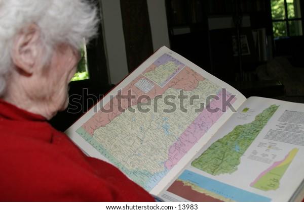 elderly woman reading