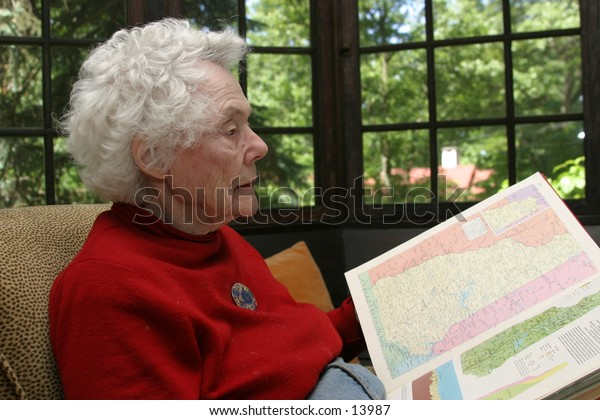 elderly woman reading