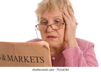 The elderly woman reads the newspaper