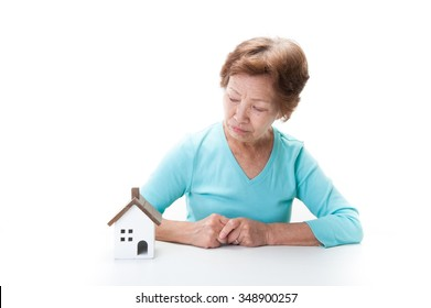 Elderly woman and residential model