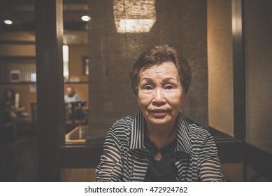 Elderly woman in a restaurant
