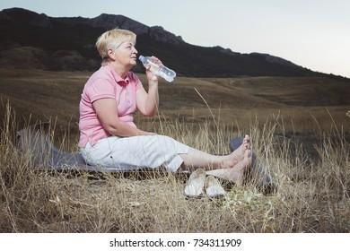 an elderly woman resting after an evening stretching