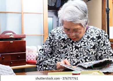 elderly woman with a sewing, Japanese
