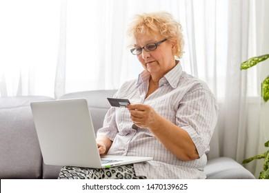an elderly woman shopping online