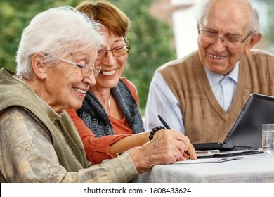 Elderly Woman Signing a Contract