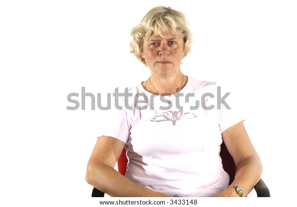 Elderly woman is sitting in a chair