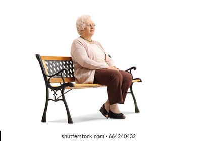 Elderly woman sitting on a bench and looking away isolated on white background