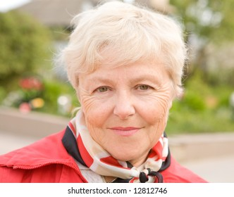 The elderly woman smiles