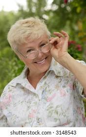 The elderly woman smiles