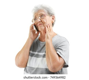 Elderly woman speaking on cell phone, isolated on white