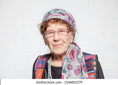 Elderly woman. Studio shot. Happy old female