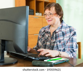 Elderly woman  studying computer literacy  in office interior