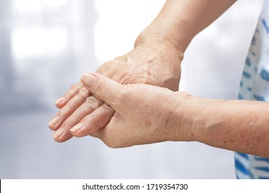 Elderly woman suffering from Beriberi pain or Peripheral neuropathiesj, Health care concept