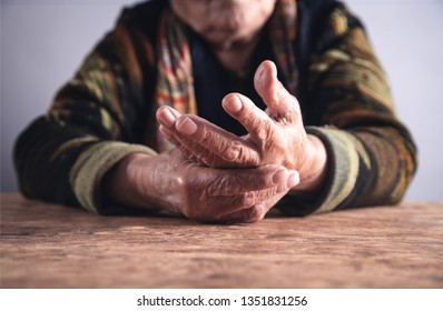 Elderly woman suffering from pain in hand. Arthritis
