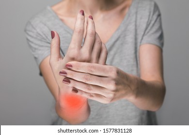 Elderly woman suffering from pain, weakness and tingling in wrist. Causes of hurt include osteoarthritis, rheumatoid arthritis, gout or wrist sprain. Health care