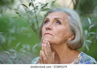 elderly woman in  summer park