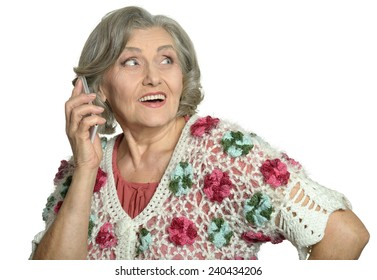 Elderly woman talking on mobile phone on white background