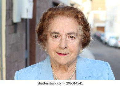 Elderly woman thinking about something in the fresh air