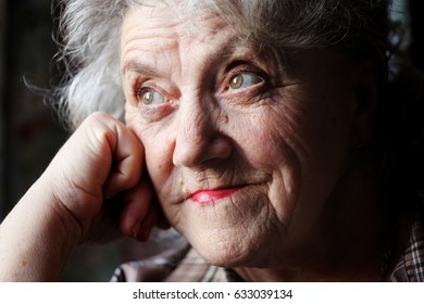 Elderly woman thoughtful face