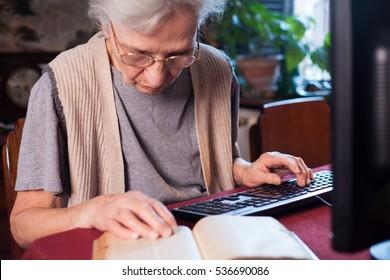 elderly woman translating a book