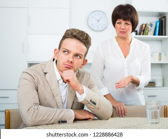 Elderly woman tries to persuade young man don't worry