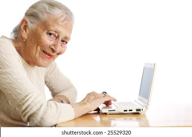 Elderly woman with ultra portable laptop computer. Shallow DOF.