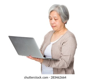 Elderly woman use of laptop computer