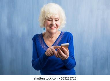An elderly woman using smartphone