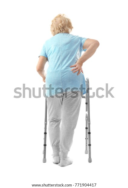 Elderly woman with walking frame on white background