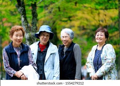 Elderly woman walking in nature