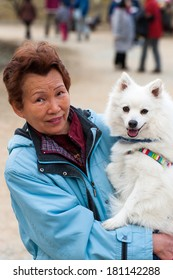 elderly woman and white dog
