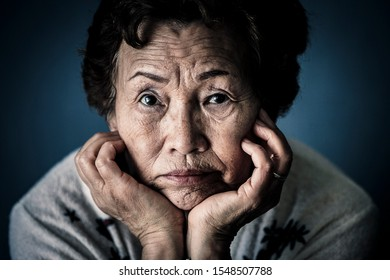 An elderly woman who has trouble and stress