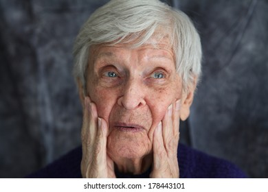 elderly woman who is surprised