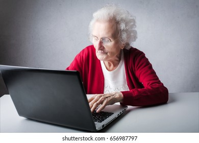 Elderly woman working at pc