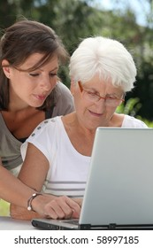Elderly woman and young woman surfing on internet
