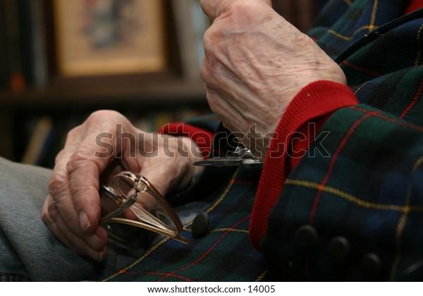 elderly woman's hands glasses