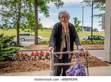 Elderly women with a walker at an assisted living facility