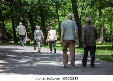 Elders, older people walking and recreationing in park in Nowa Huta.