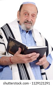 Eldery jewish man with kippah and wrapped in talit praying. Religion concept. Isolated white background